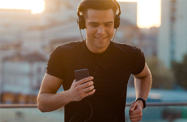 Man running on street with headphones