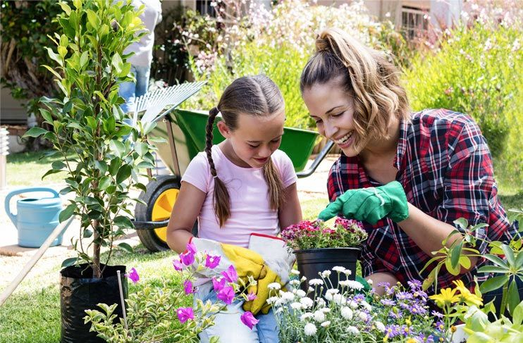 Mother and daughter gardening and doing home improvement