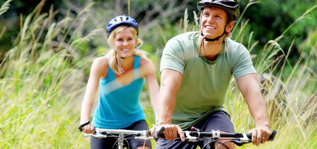 Man and woman cycling in nature